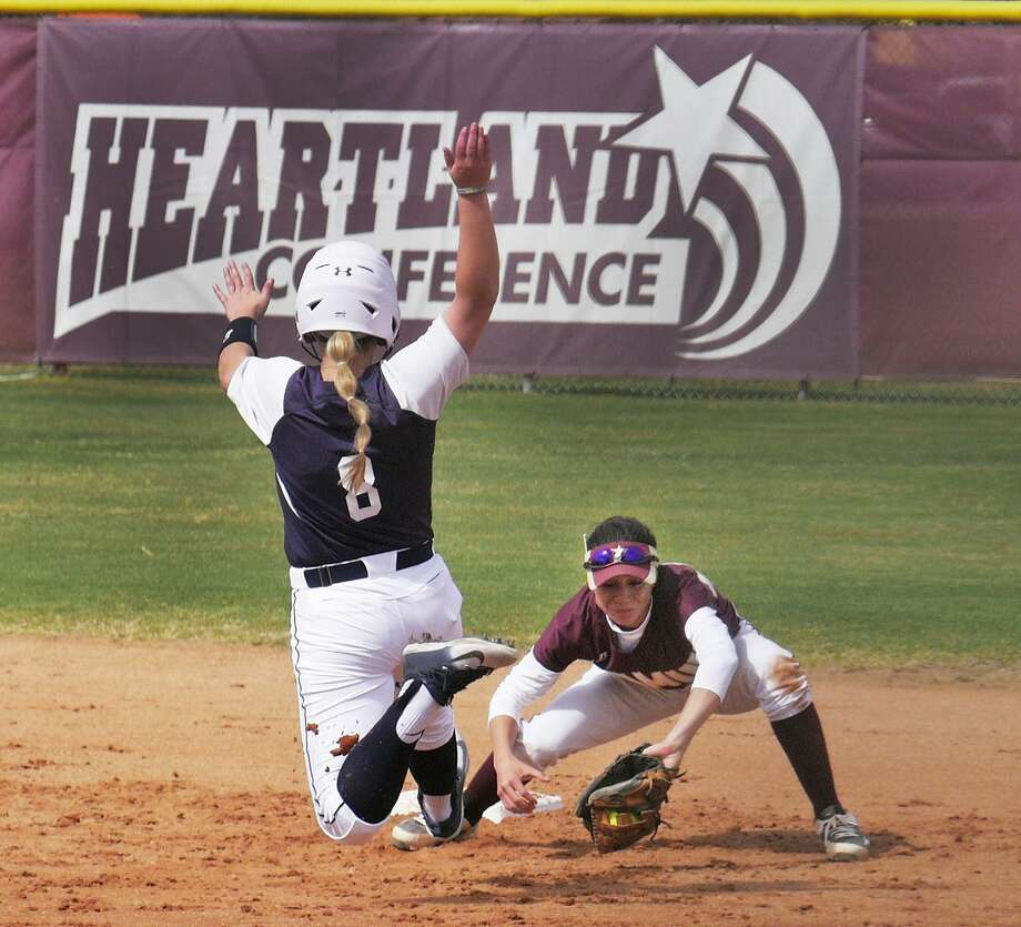 Shortstop Alyssa Acuna had a two-run double to give TAMIU a 4-2 lead in the fifth, but the school couldn't hold off No. 2 Angelo State on its home field in a 5-4 loss. The Dustdevils also lost 4-1 to Adams State and played a second game vs. ASU losing 10-0 in five innings. Photo: Cuate Santos /Laredo Morning Times File / Laredo Morning Times