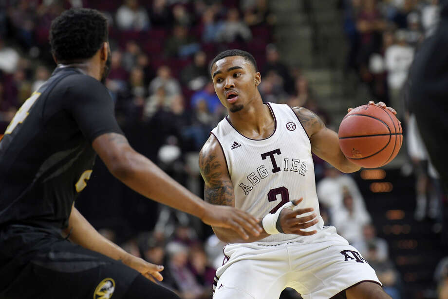 "Texas A&M's T.J. Starks, right, knows the ""tough love"" exhibited by his coaches will help turn the freshman into a difference-making guard for the Aggies this season and beyond. Photo: Laura McKenzie, MBR / College Station Eagle"