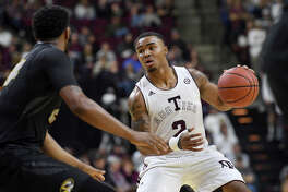 """Texas A&M's T.J. Starks, right, knows the """"tough love"""" exhibited by his coaches will help turn the freshman into a difference-making guard for the Aggies this season and beyond."""
