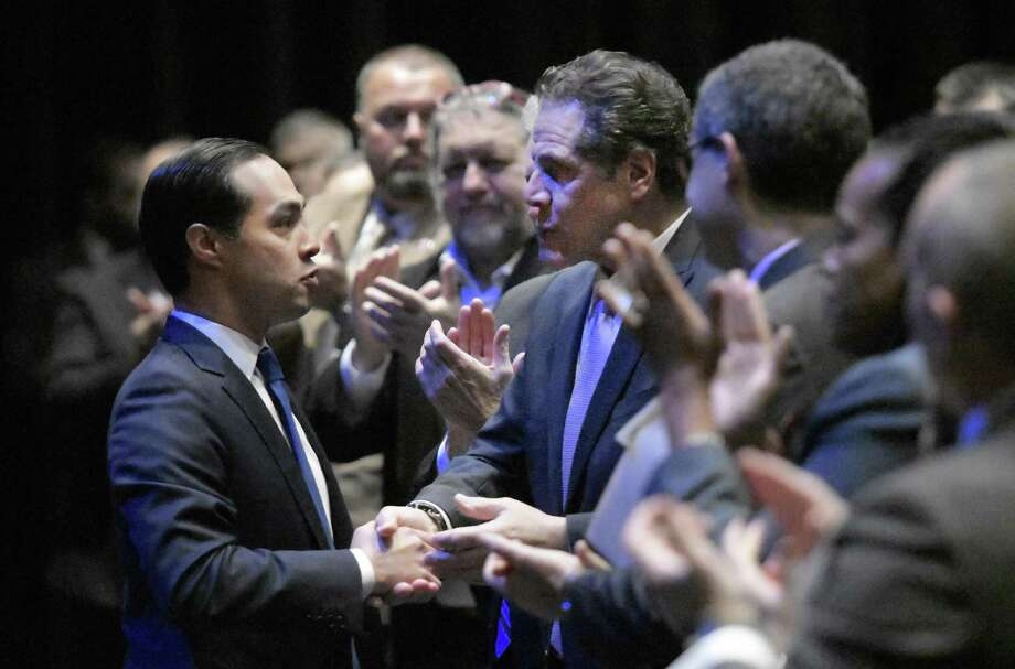 HUD Secretary Julian Castro (left) is greeted by New York Gov. Andrew Cuomo and a standing ovation after addressing the Governor's Regional Conference on Sustainable Community Development in this 2016 photo. He plans to decide whether to enter the quest for the 2020 nomination by the end of the year. Photo: Albany Times Union File Photo / 20038973A