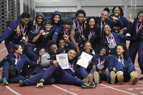 Hillhouse celebrates their win at the SCC track and field championships, Feb. 2, 2018, at Floyd Little Athletic Center in New Haven.