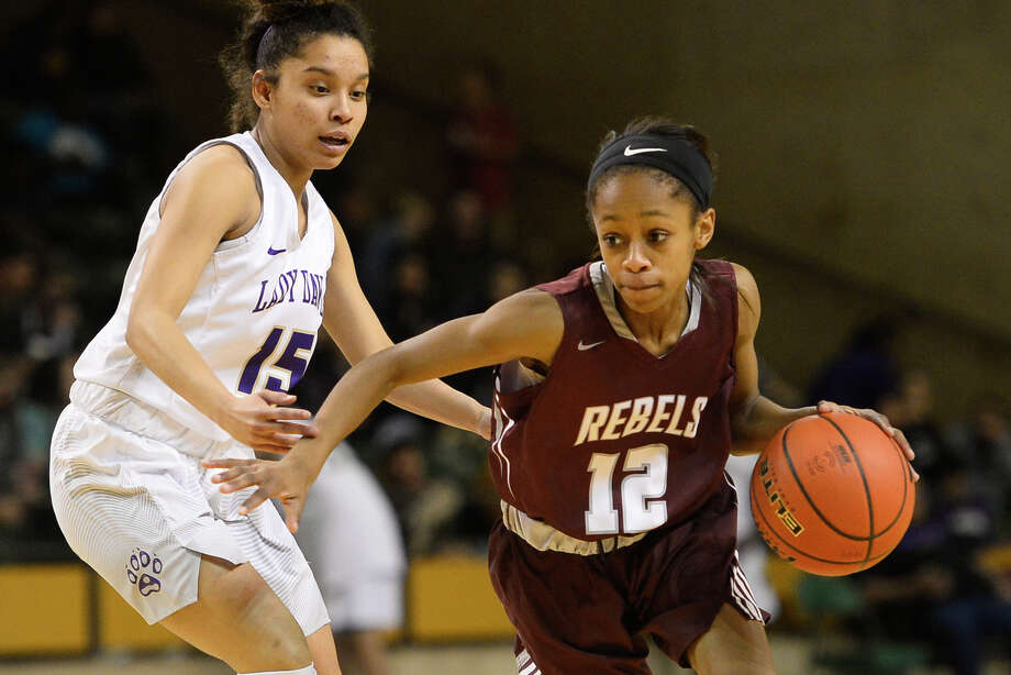 Lee's Destiny Stanford (12) dribbles against Midland High's Sadie Govan (15) Feb. 2, 2018, at Chaparral Center. James Durbin/Reporter-Telegram Photo: James Durbin