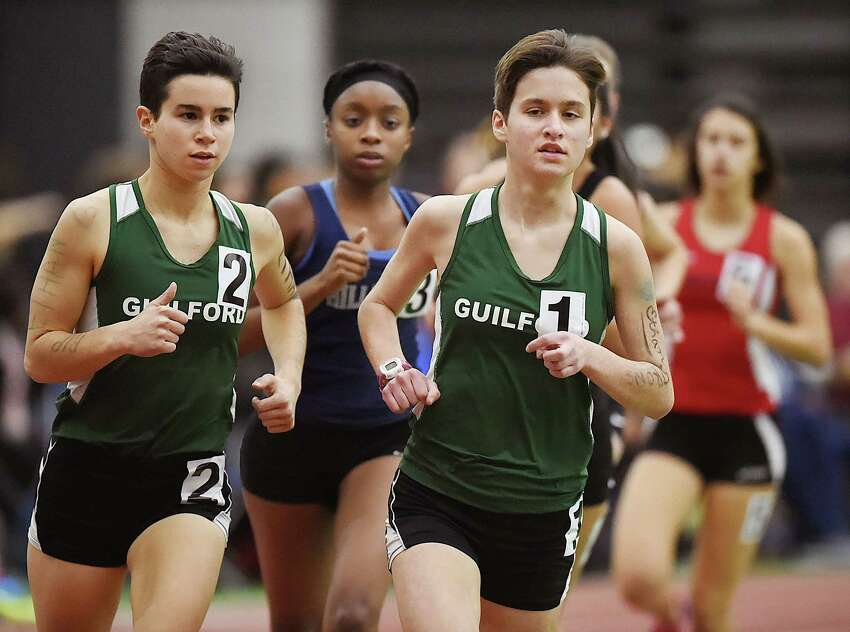 Guilford's Meredith Bloss, (wearing #1) wins the 1600 meter run in 5:32.41 and senior Jacqueline Guerra (#2) placed second in 5:35.72 at the SCC track and field championships, Feb. 2, 2018, at Floyd Little Athletic Center in New Haven. Bloss, a junior won the 3200 meter run in 12:00.66 and Guerra finished second in 12:04.12.