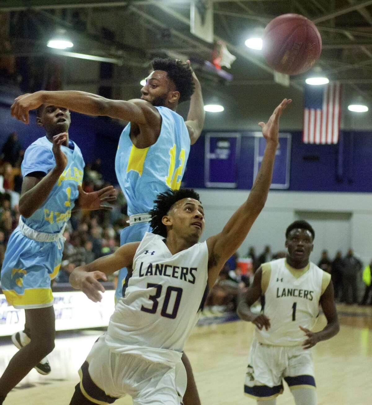 Notre Dame's Tyler Bourne lays up the ball as Kolbe Cathedral's Quinton Sneed defends during their SWC boys basketball clash Friday night at th e University of Bridgeport. Bourne scored 27 points to lead the Bulld ogs to victory.