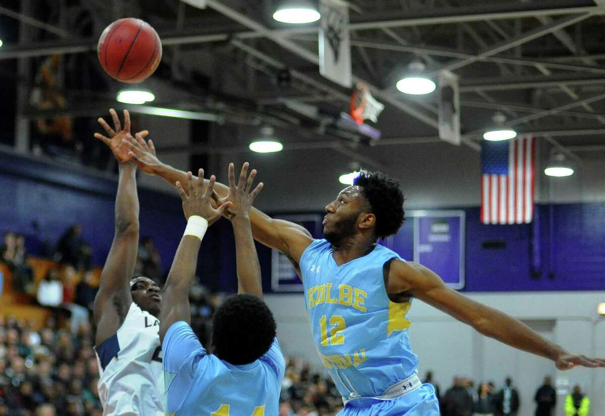 Notre Dame of Fairfield's Josh Reaves aatempts a shot as Kolbe Cathedral's Quinton Sneed defends during basketball action at University of Bridgeport in Bridgeport, Conn., on Friday Feb. 2, 2018.