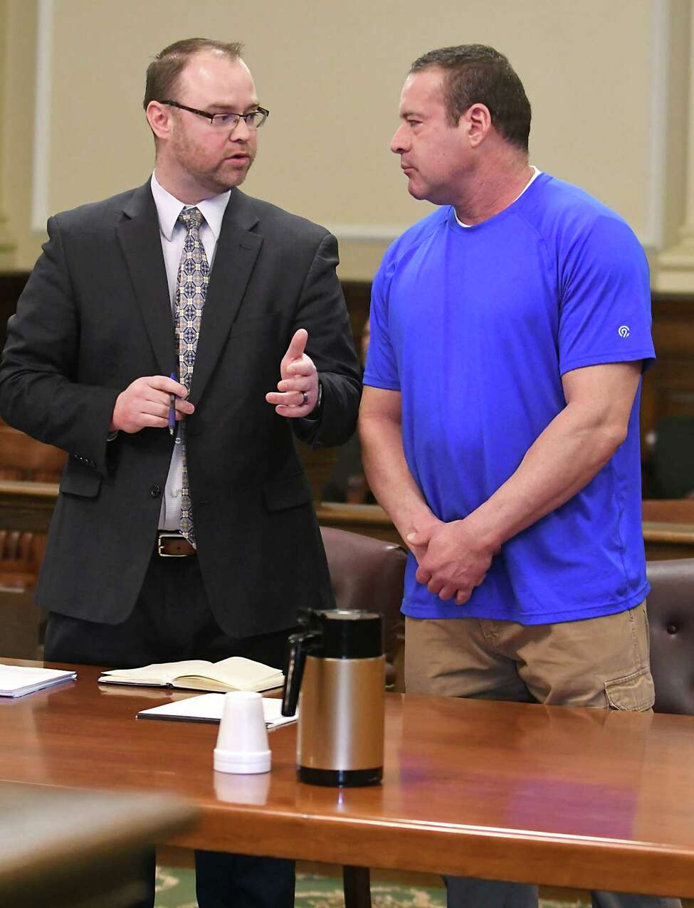 Defense attorney Shane Hug, left, stands with his client Troy Police Sgt. Ronald Epstein as Albany County Court Judge Peter Lynch opens a sealed indictment at the Rensselaer County Court House on Friday, Feb. 2, 2018, in Troy, N.Y. (Lori Van Buren/Times Union)