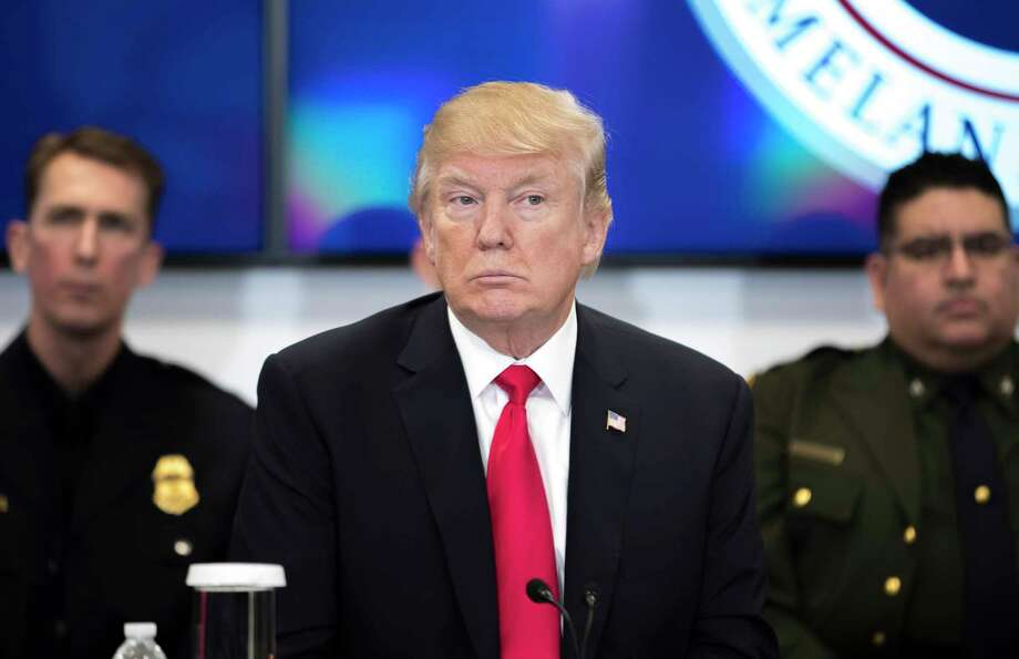 """President Donald Trump participates in a discussion at the Customs and Border Protection National Targeting Center in Sterling, Va., Feb. 2, 2018. Trump on Friday intensified his attacks on his own Justice Department and FBI for their handling of the investigation into Russia's interference in the 2016 elections, hinting that senior leaders there should face consequences for conduct he called """"a disgrace."""" (Tom Brenner/The New York Times) Photo: TOM BRENNER / NYTNS"""