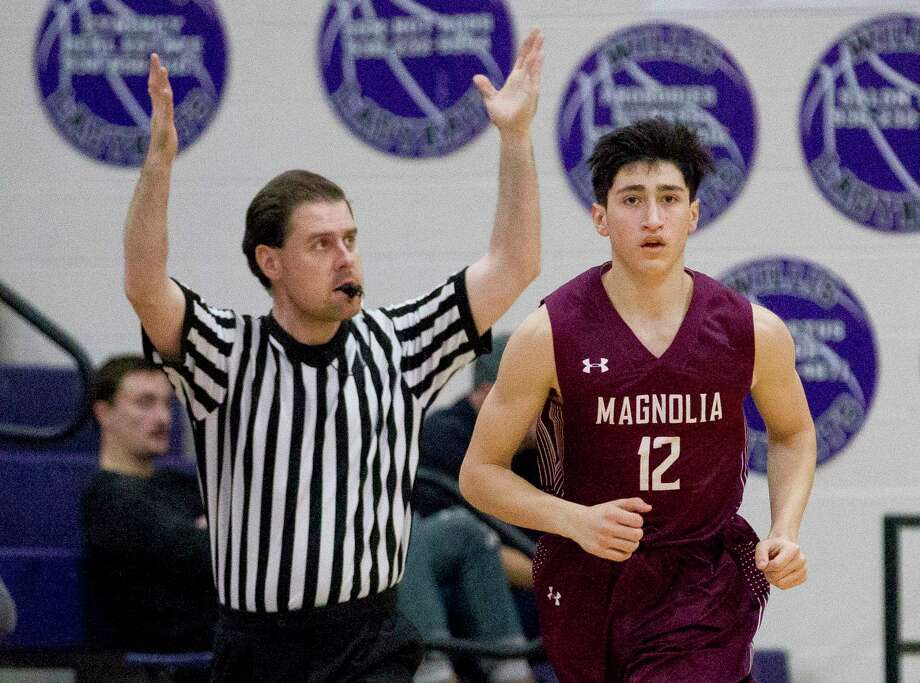 Magnolia point guard Evan Palmquist (12) is seen after making a three-pointer during the first quarter of a District 20-5A basketball game at Willis High School, Friday, Feb. 2, 2018, in Willis. Photo: Jason Fochtman, Staff Photographer / © 2018 Houston Chronicle
