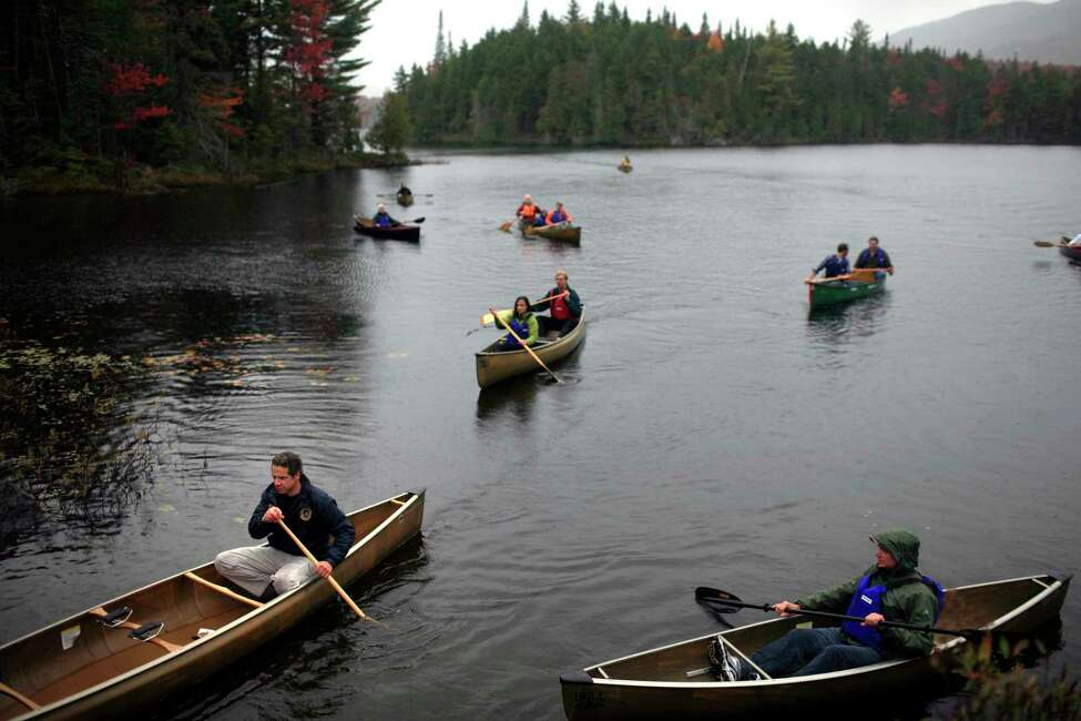 New York Gov. Andrew Cuomo during a canoeing trip with members of his administration, on one of the Boreas Ponds in the Adirondacks, in North Hudson, N.Y., Sept. 23, 2012. The trip was intended, in part, to promote the area as a tourist destination and to highlight the 69,000 acres the state is acquiring for preservation. (Nathaniel Brooks/The New York Times)