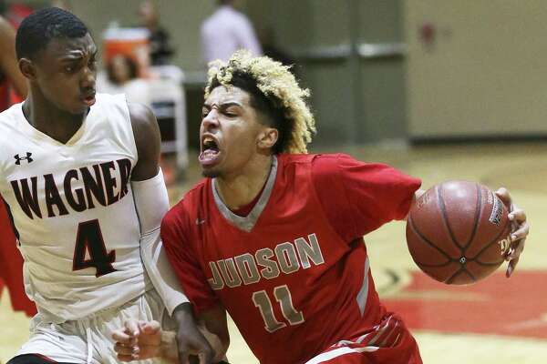 Judson's Questyn Luckey pushes the ball into the lane against Wagner's Jalen Jackson as Wagner hosts Judson in boys basketball at on February 2, 2018.