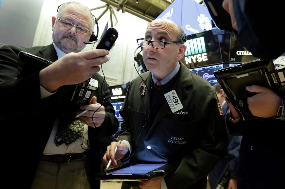 Traders Robert Moran, left, and Andrew Silverman work on the floor of the New York Stock Exchange, Friday, Feb. 2, 2018. Technology companies were leading stocks broadly lower in early trading, extending the market's slide into a second day. (AP Photo/Richard Drew) Photo: Richard Drew, STF / AP