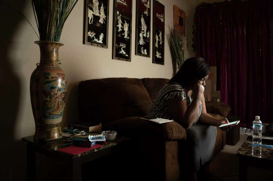 Shanda Carter, 51, reads the update of the lawsuit of her husband of three years, Michael Carter, 39, in her apartment on Friday, Feb. 2, 2018, in Seabrook. Michael is a heat-sensitive inmate with diabetes who was assigned to the Pack Unit in Navasota, northwest of Houston. He could live on a unit with air conditioning after a federal judge in Houston approved a deal between the prison and the inmates who sued. Photo: Yi-Chin Lee, Houston Chronicle / © 2018  Houston Chronicle