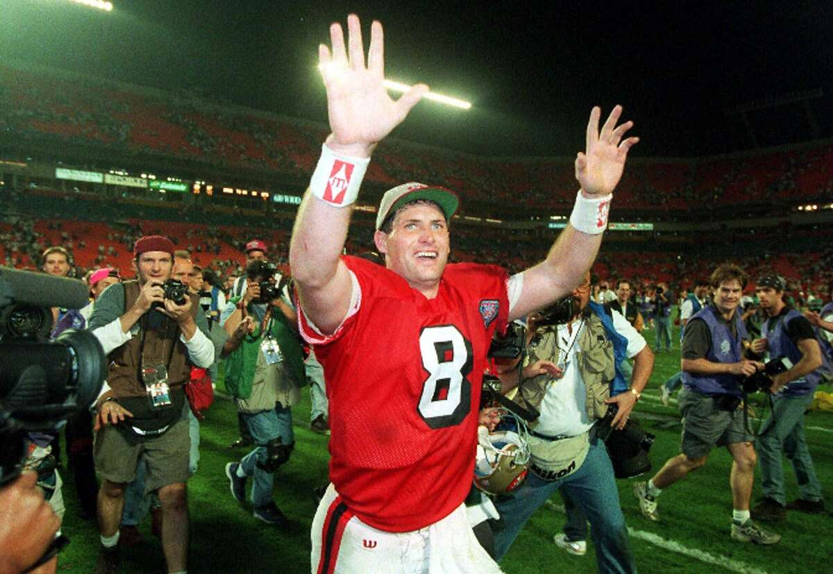 San Francisco 49ers quarterback Steve Young runs a victory lap after the 49ers beat the San Diego Chargers on Sunday, Jan. 29, 1995 in Super Bowl XXIX at Joe Robbie Stadium in Miami, Fla. Steve Young is calling it quits, reluctantly. The two-time league MVP, who led the San Francisco 49ers to a Super Bowl title in 1995, will announce his retirement Monday, June 12, 2000. (AP Photo/Lenny Ignelzi)