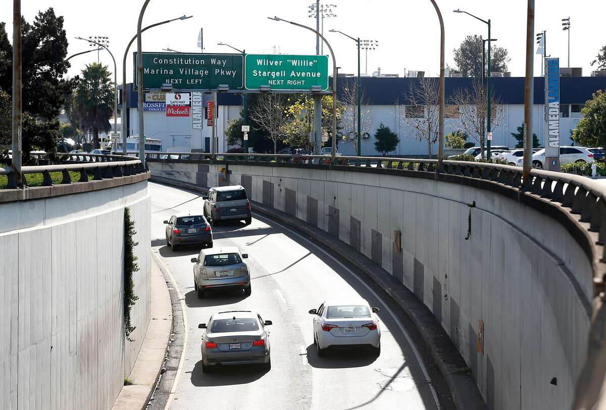 Cars emerge from the Webster Street Tube into Alameda, Calif. on Friday, Feb. 2, 2018. The Alameda City Council will vote on a plan to install license plate readers at all entry points into the island city.