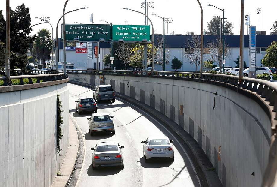 Cars emerge from the Webster Street Tube into Alameda on Friday, Feb. 2, 2018. The Alameda City Council voted on Tuesday to set aside $500,000 for license plate readers at all entry points into the island city. Photo: Paul Chinn, The Chronicle