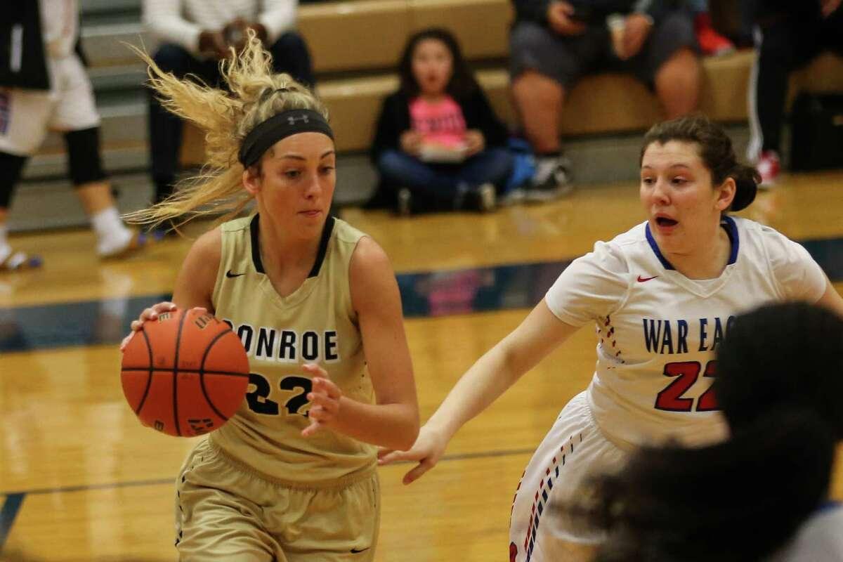 ConroeÂ?'s Riley Halloran (22) drives downcourt as Oak RidgeÂ?'s Devan Caldwell (22) defends during the girls basketball game on Tuesday, Jan. 30, 2018, at Oak Ridge High School. (Michael Minasi / Houston Chronicle)