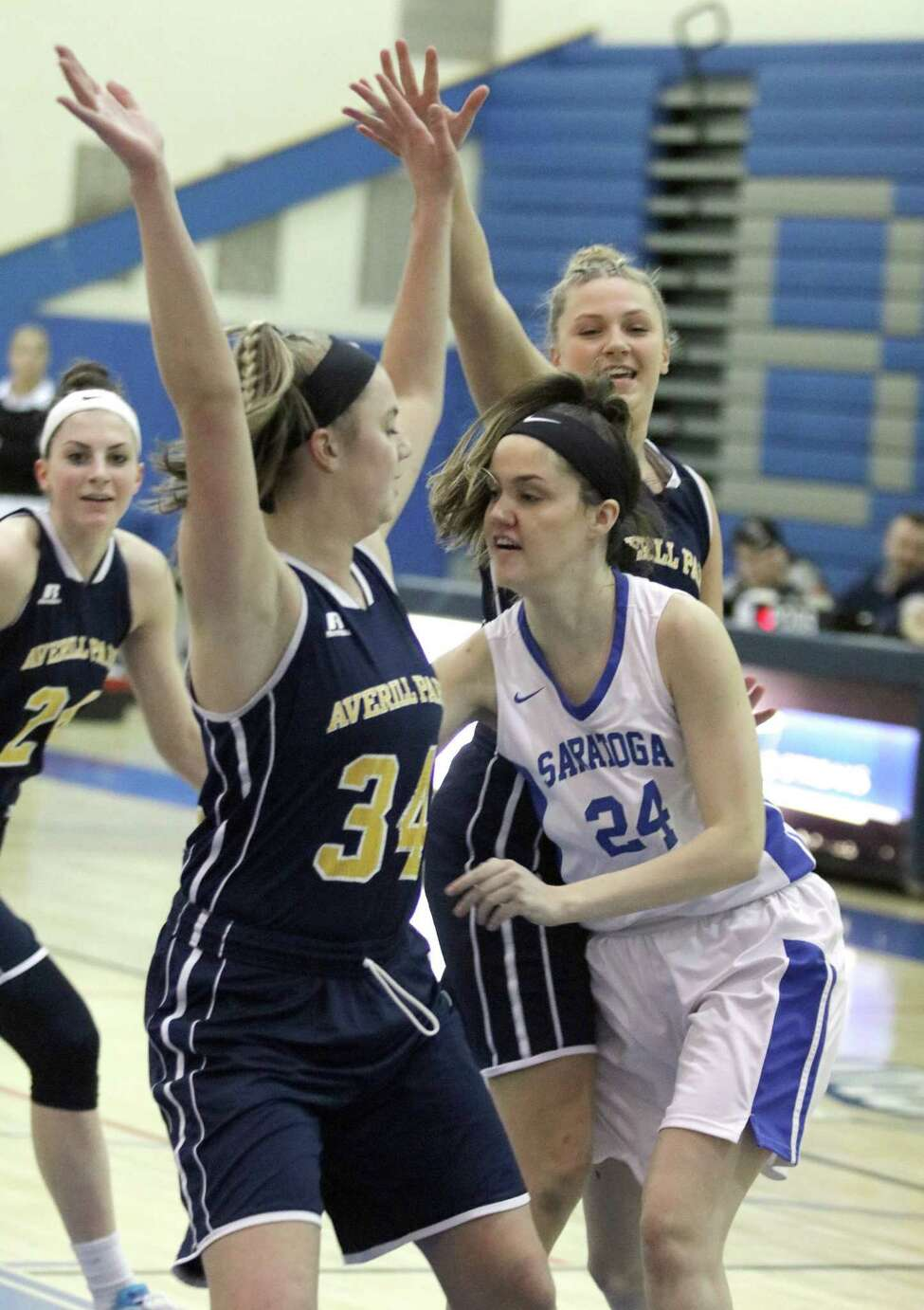 Saratoga's Aleida Woldring passes the ball behind Averill Park defender Kelsey Wood during girls varsity basketball action at Saratoga Springs High School Friday, Feb. 2, 2018. (Ed Burke - Special to The Times Union)