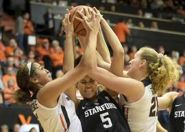 Oregon State forward Taya Corosdale, left, and center Marie Gulich, right, battle for a rebound with Stanford's Kaylee Johnson in the first half of an NCAA college basketball game in Corvallis, Ore., Friday, Feb. 2, 2018. (Andy Cripe/The Corvallis Gazette-Times via AP)