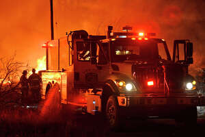Members of the Midland Fire Department and surrounding volunteer departments work a massive fire at Trinity Pallets, Inc. on S. Highway 349 that started late on the night of Feb. 3, 2018, and continued into the early morning hours of Feb. 4. James Durbin/Reporter-Telegram