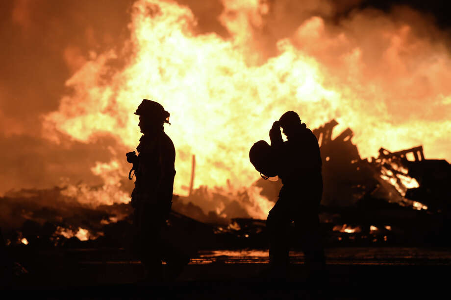 Members of the Midland Fire Department and surrounding volunteer departments work a massive fire at Trinity Pallets, Inc. on S. Highway 349 that started late on the night of Feb. 2, 2018, and continued into the early morning hours of Feb. 3. James Durbin/Reporter-Telegram Photo: James Durbin