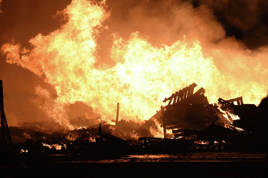 Members of the Midland Fire Department and surrounding volunteer departments work a massive fire at Trinity Pallets, Inc. on S. Highway 349 that started late on the night of Feb. 2,2018,and continued into the early morning hours of Feb. 3. James Durbin/Reporter-Telegram Photo: James Durbin