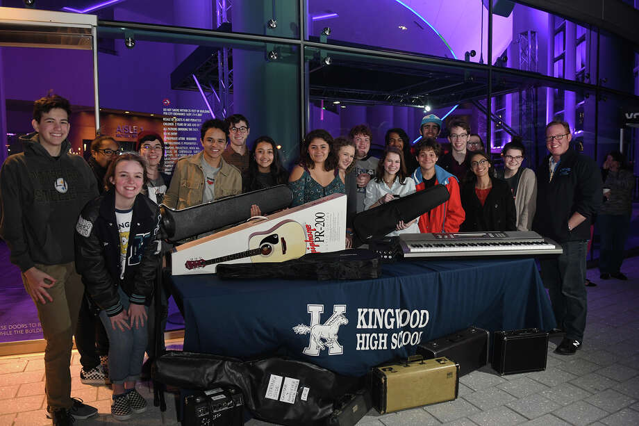 Members of the Kingwood High School Choir, led by teacher Jason Watt, right, show off the musical instruments donated to the Humble ISD Fine Arts program before the Barry Manilow concert at the Smart Financial Centre in Sugar Land on Feb. 2, 2018. Photo: Jerry Baker, Freelance / Freelance