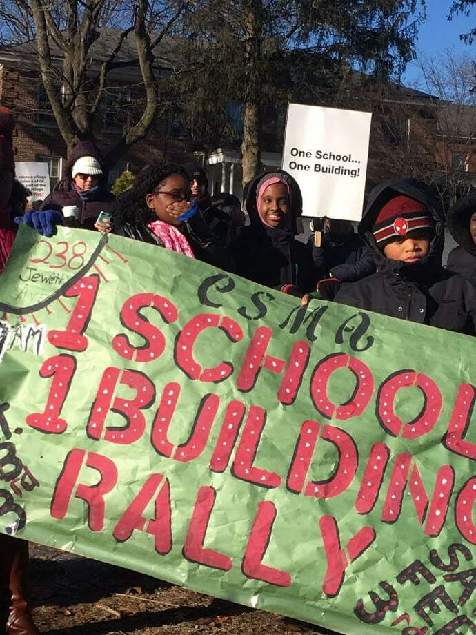 Classical Studies Magnet Academy students and parents rally for one school building on Feb. 3, 2018. They want to move into a building on Jewett Avenue in Bridgeport that the Diocese of Bridgeport wants to sell. Photo: Linda Conner Lambeck /