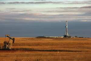 This oil drilling rig is near Watford City, N.D. Bakken output is set to exceed the December 2014 record of 1.23 million barrels a day in the first half of 2018, a state official says.