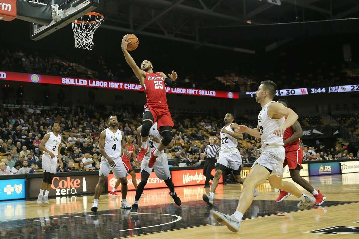 ORLANDO, FL - FEBRUARY 03: Galen Robinson Jr. #25 of the Houston Cougars attempts a shot past A.J. Davis #3 and Ceasar DeJesus #4 of the UCF Knights during a NCAA basketball game at the CFE Arena on February 3, 2018 in Orlando, Florida. (Photo by Alex Menendez/Getty Images)