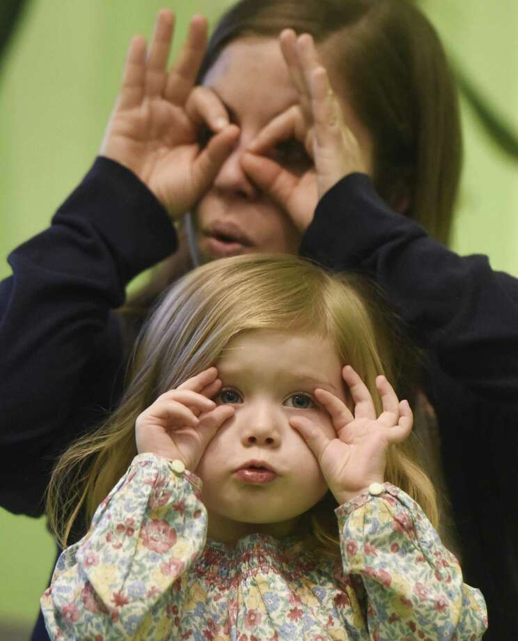 Greenwich's Maria Pizarello, 2, and her mother, Maria Pizarello, hoot like an owl during the Museum Musicians program at the Bruce Museum in Greenwich, Conn. Thursday, Feb. 1, 2018. Designed for children 10- to 24-months, the interactive music and movement program gives tots and their caregivers a chance to sing, dance and play instruments to songs inspired by the museum's exhibits. Photo: Tyler Sizemore / Hearst Connecticut Media / Greenwich Time