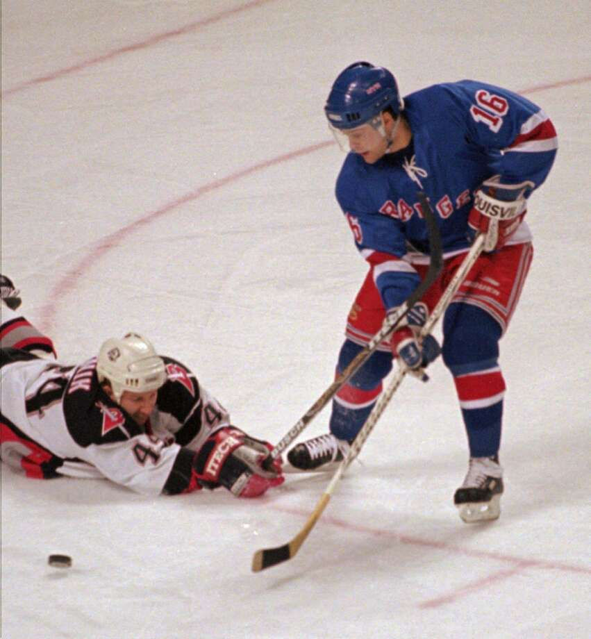 "New York Rangers center Pat LaFontaine (16) skates past Buffalo Sabres defenseman Alexei Zhitnik (44) during the first period in this Dec. 26, 1997 photo at the Marine Midland Arena in Buffalo, N.Y. LaFontaine, a Greenwich resident, will help present ""This Is Your Brain On Sports"" in Greenwich Feb. 13. Photo: CHARLES AGEL / AP / AP"