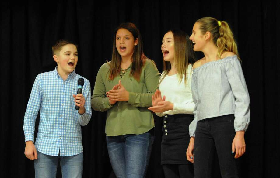 "From left to right Colin Konstanty, 13, Peyton Lampugnale, 12, Sophia Blum, 12, and Anna Moody, 12, sing ""This is Me"" from the musical ""The Greatest Showman"" during the 3rd Annual Leah Rondon Birthday Bash benefit indoor carnival to honor the life of Leah Rondon at Kolbe Cathedral in Bridgeport, Conn., on Saturday Feb. 3, 2018. These children attend Bedford Middle School in Westport where Leah's mom Colleen works as a teacher. The carnival's proceeds benefit the Leah Rondon Memorial Scholarship Fund. Photo: Christian Abraham / Hearst Connecticut Media / Connecticut Post"