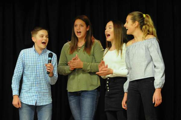 "From left to right Colin Konstanty, 13, Peyton Lampugnale, 12, Sophia Blum, 12, and Anna Moody, 12, sing ""This is Me"" from the musical ""The Greatest Showman"" during the 3rd Annual Leah Rondon Birthday Bash benefit indoor carnival to honor the life of Leah Rondon at Kolbe Cathedral in Bridgeport, Conn., on Saturday Feb. 3, 2018. These children attend Bedford Middle School in Westport where Leah's mom Colleen works as a teacher. The carnival's proceeds benefit the Leah Rondon Memorial Scholarship Fund."