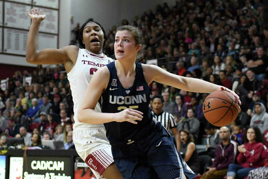 UConn's Kyla Irwin, right, drives around Temple's Shantay Taylor during a recent game. Irwin's mother Bethany is a former Branford High All-State selection. Photo: John Woike / Tribune News Service / Hartford Courant
