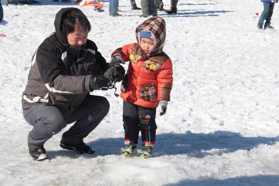 The 12th annual Connecticut Department of Energy and Environmental Protection's No Child Left Inside free Winter Festival was held Saturday, Feb. 3, 2018 at Burr Pond State Park in Torrington. Activities planned for the day included ice fishing, a fish fry, snowshoeing, ice sculpting, snow play, wildlife tracks, winter hikes and ice safety rescue demonstrations by the Torrington Fire Department, LL Bean and BASS Pro demos. Visits from Resources in Search and Rescue and the Hartford Wolfpack mascot, winter games, a marshmallow roast, bonfire and storytelling. Photo: Anita Garnett / For Hearst Connecticut Media
