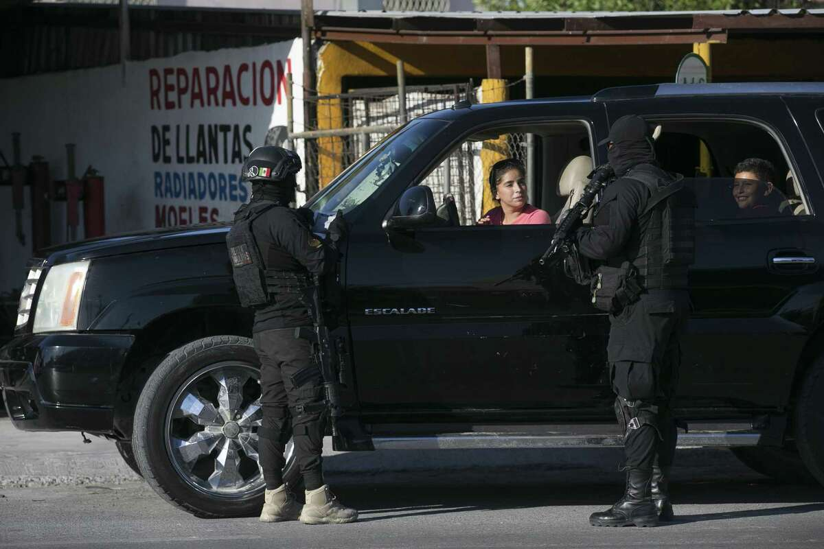 Tamaulipas State Police work a checkpoint in Reynosa, Mexico, Sunday, Nov. 5, 2017. Tamaulipas Gov. Francisco Cabeza de Vaca initiated the checkpoints in October as an effort to curb criminal group?•s violence including carjackings. The police searches for stolen vehicles, drugs and guns.