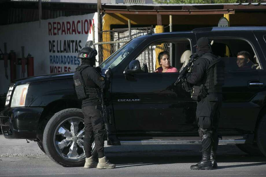 Tamaulipas State Police work a checkpoint in Reynosa, Mexico, Sunday, Nov. 5, 2017. Tamaulipas Gov. Francisco Cabeza de Vaca initiated the checkpoints in October as an effort to curb criminal groupÕs violence including carjackings. The police searches for stolen vehicles, drugs and guns. Photo: JERRY LARA / San Antonio Express-News / San Antonio Express-News