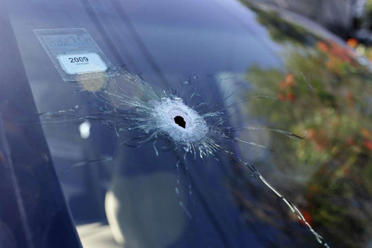 A bullet hole is seen on the windshield of a vehicle in a centrally located neighborhood of Reynosa, Mexico, Sunday, Nov. 5, 2017. According to Tamaulipas State Police, armed men carried out an ?'adjuste de cuentas,?