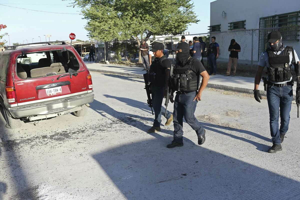 Tamaulipas State Police check out the scene of a double shooting in a centrally located neighborhood of Reynosa, Mexico, Sunday, Nov. 5, 2017. According to the police, the shootings stem from an ?'adjuste de cuentas,?