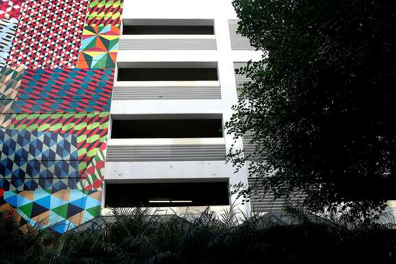 Murals are painted on the Moscone Center parking garage on Third Street in San Francisco, Calif. on Saturday, Feb. 3, 2018. The city-operated garage may be demolished and replaced with affordable housing.