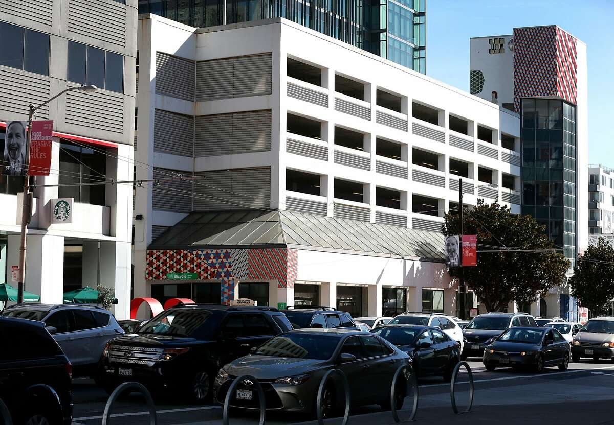 Traffic heading north on Third Street drives past the Moscone Center parking garage in San Francisco, Calif. on Saturday, Feb. 3, 2018. The city-operated garage may be demolished and replaced with affordable housing.