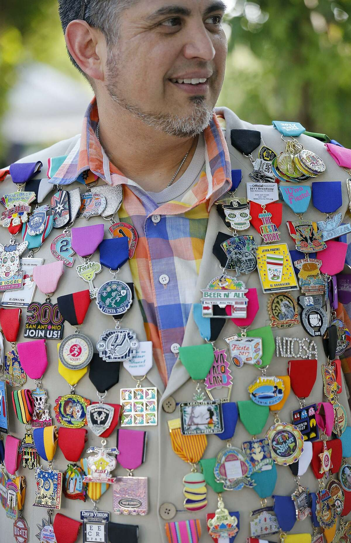 Buddy Sanchez wears medals on his vest during the Fiesta Fiesta event in 2017 at Hemisfair Park.