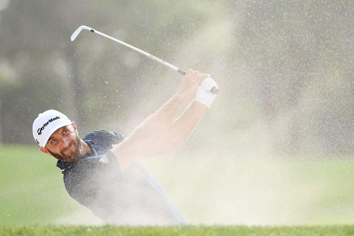 ABU DHABI, UNITED ARAB EMIRATES - JANUARY 21: Dustin Johnson of the United States plays his second shot on the 13th hole during the final round of the Abu Dhabi HSBC Golf Championship at Abu Dhabi Golf Club on January 21, 2018 in Abu Dhabi, United Arab Emirates. (Photo by Ross Kinnaird/Getty Images)