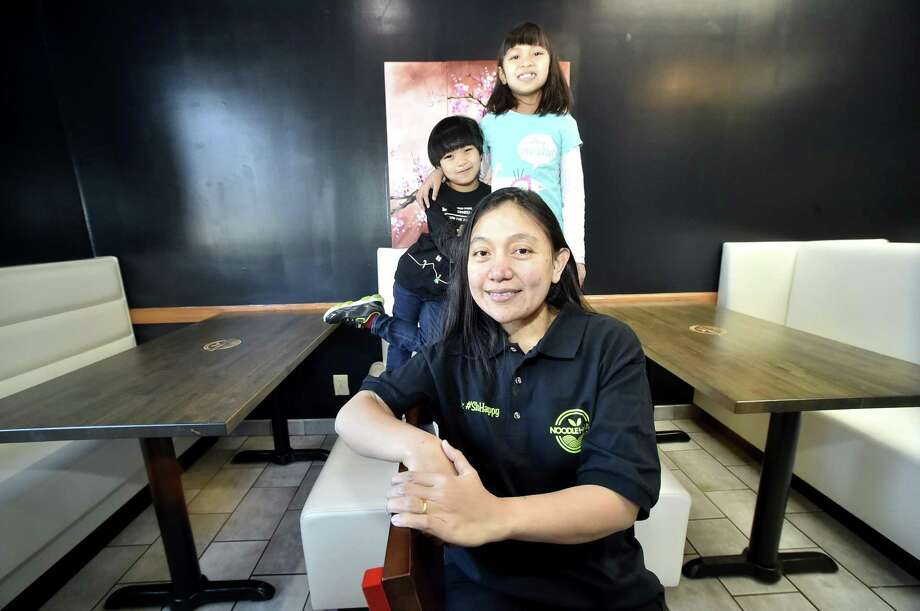 Soraya Kaoroptham, owner of Noodle House on the Boston Post Road in Orange, with her son, A.J. Kaoroptham, 5, and daughter, Anaya Kaoroptham, 8, at the restaurant. Photo: Peter Hvizdak / Hearst Connecticut Media / New Haven Register