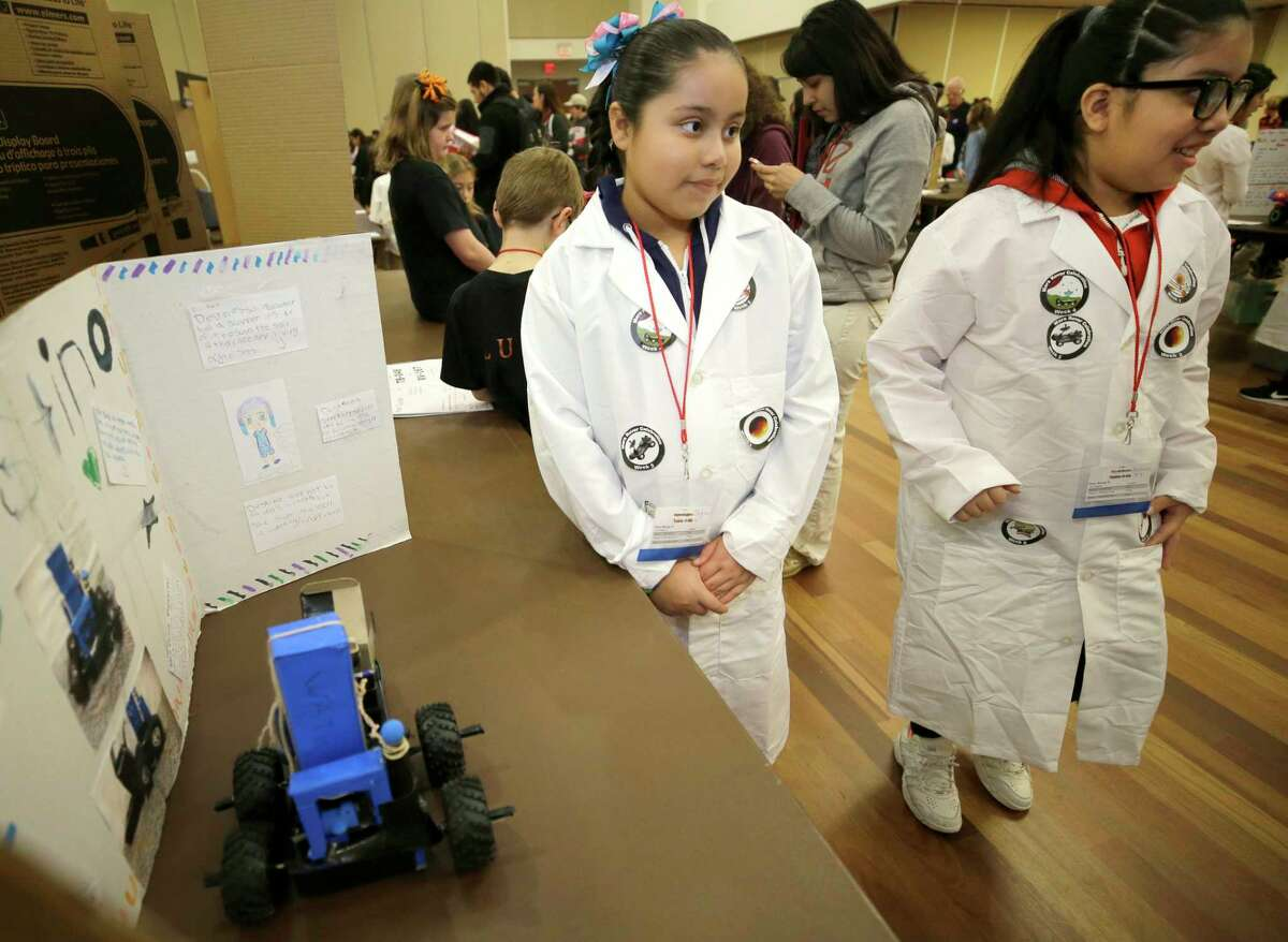 Ashley Martinez, 9, left, and Evelyn Ramirez, 9, right, both fourth graders at Aldine ISD's Stephens Elementary wait for their display to be judged during the STEM Mars Rover Celebration at the University of Houston on Jan. 27, 2018, in Houston. Stephens Elementary went from a state accountability score that would have suggested a D grade last year to an A this year. (Melissa Phillip / Houston Chronicle)