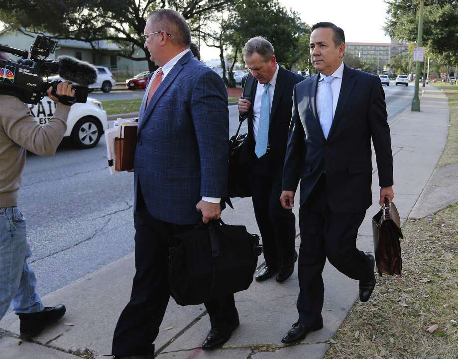 State Sen. Carlos Uresti (right) leaves with his attorneys from the John Wood Federal Courthouse after another day of testimony surrounding his indictment last year on 11 felony charges, including conspiracy to commit wire fraud, securities fraud and money laundering, in connection with his role at FourWinds Logistics. (Kin Man Hui/San Antonio Express-News) Photo: Kin Man Hui, Staff / San Antonio Express-News / ©2018 San Antonio Express-News