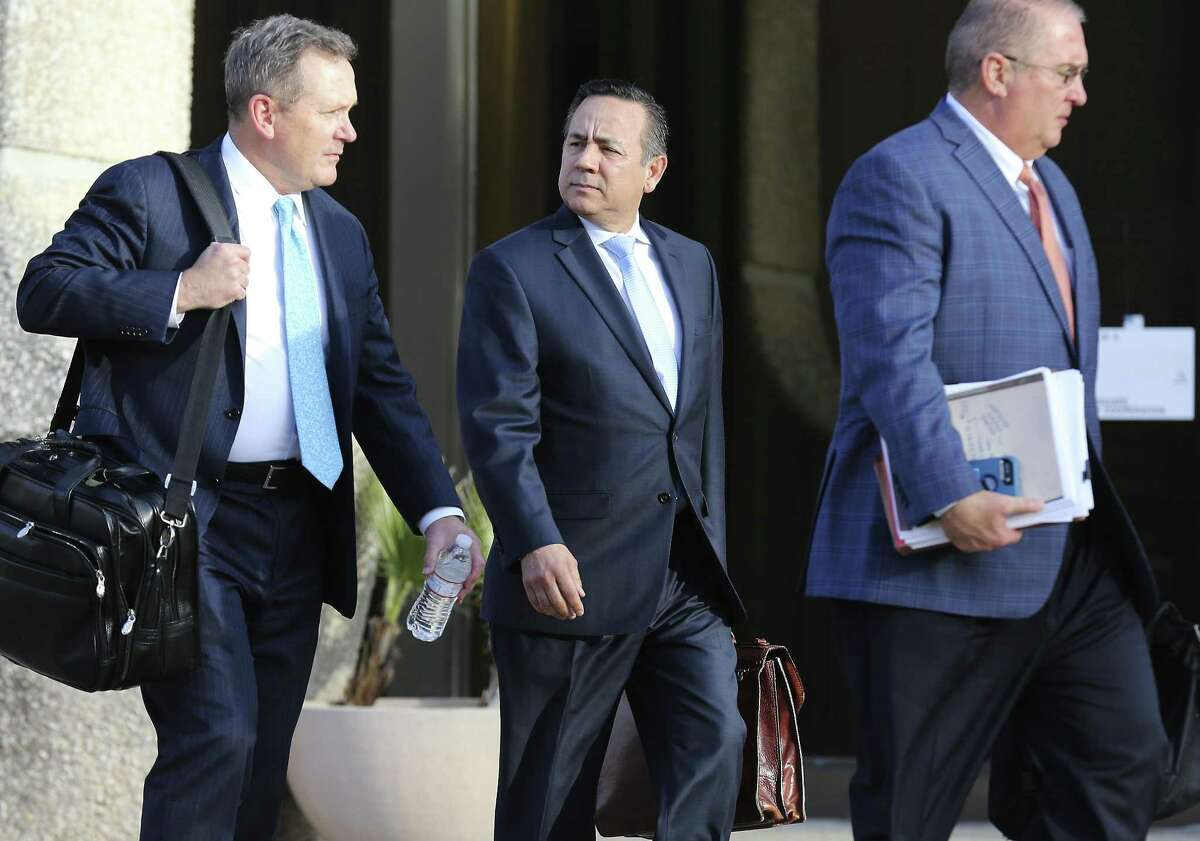 State Sen. Carlos Uresti (center) leaves with his attorneys from the John Wood Federal Courthouse after another day of testimony surrounding his indictment last year on 11 felony charges, including conspiracy to commit wire fraud, securities fraud and money laundering, in connection with his role at FourWinds Logistics. (Kin Man Hui/San Antonio Express-News)
