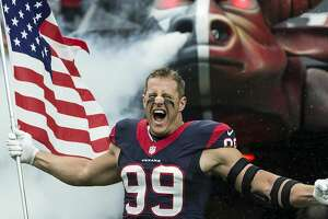 Houston Texans defensive end J.J. Watt carries a flag as he runs onto the field during pre-game ceremonies before an NFL football game between the Texans and the New York Jets at NRG Stadium on Sunday, Nov. 22, 2015, in Houston. ( Brett Coomer / Houston Chronicle )