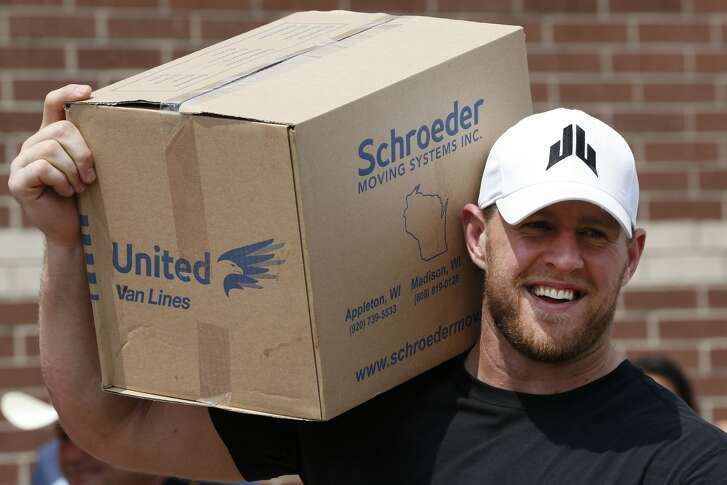 Houston Texans defensive end J.J. Watt holds a box of relief supplies on his shoulder while handing them out to people impacted by Hurricane Harvey on Sunday, Sept. 3, 2017, in Houston. J.J. Watt's Hurricane Harvey Relief Fund, which raised more than $17 million to date to help those affected by the storm. ( Brett Coomer / Houston Chronicle, POOL )