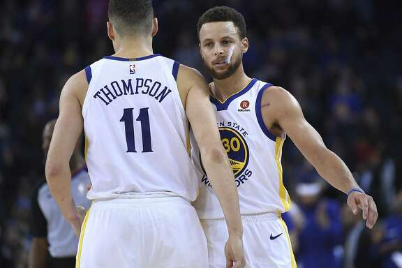 OAKLAND, CA - JANUARY 08:  Klay Thompson #11 and Stephen Curry #30 of the Golden State Warriors celebrates after they defeated the Denver Nuggets 124-114 during an NBA Basketballl game at ORACLE Arena on January 8, 2018 in Oakland, California. NOTE TO USER: User expressly acknowledges and agrees that, by downloading and or using this photograph, User is consenting to the terms and conditions of the Getty Images License Agreement. (Photo by Thearon W. Henderson/Getty Images)